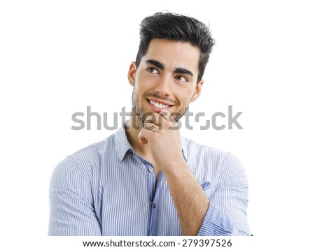 Portrait of a handsome young man thinking on something, isolated on white background - stock photo