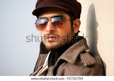 portrait of a handsome young man with attitude, portrait of a handsome man wearing jacket and sunglasses - stock photo
