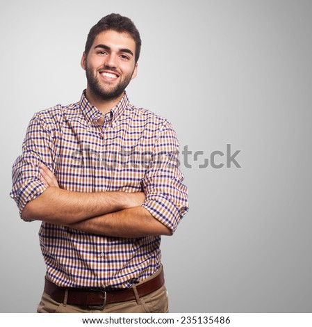 Portrait of a handsome young man with crossed arms - stock photo