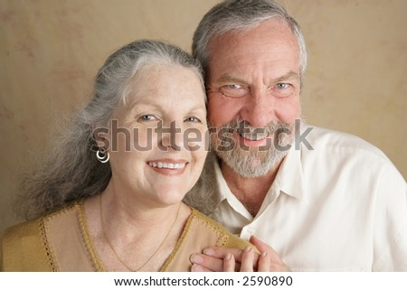Portrait of a happily married, attractive middle aged couple. - stock photo