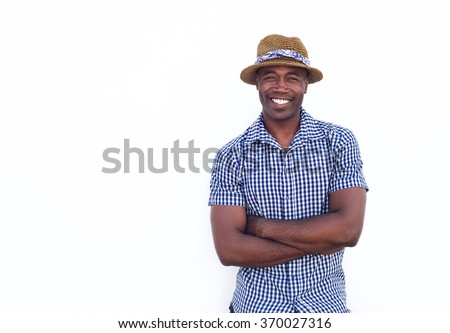 Portrait of a happy african american guy smiling with hat on white background - stock photo