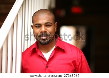 Portrait of a happy African American man. Shallow DOF. - stock photo