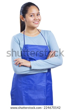 Portrait of a happy and smiling young housekeeper. Isolated in white background. - stock photo