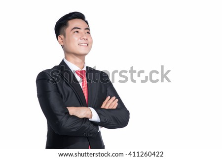 Portrait of a happy asian businessman looking upwards. Looking in future with smile