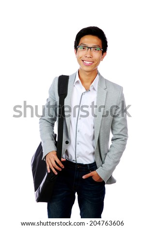 Portrait of a happy asian man standing with briefcase over white background - stock photo