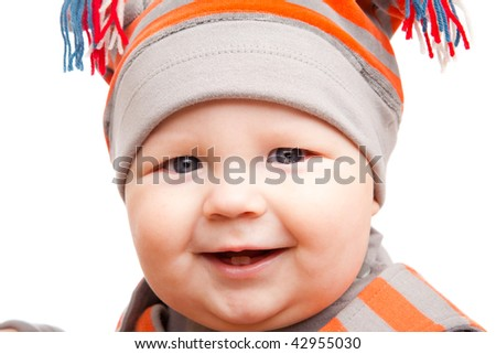 Portrait of a happy baby boy in hat - stock photo