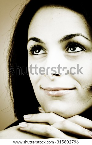 Portrait of a happy beautiful woman with green eyes.