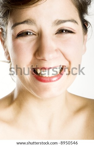 Portrait of a happy beautiful young woman laughing