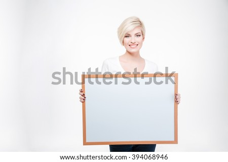 Portrait of a happy blonde woman holding blank board isolated on a white background - stock photo