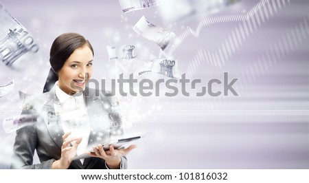 Portrait of a happy brunette woman with tablet computer - money appearing from the screen. Online commerce concept