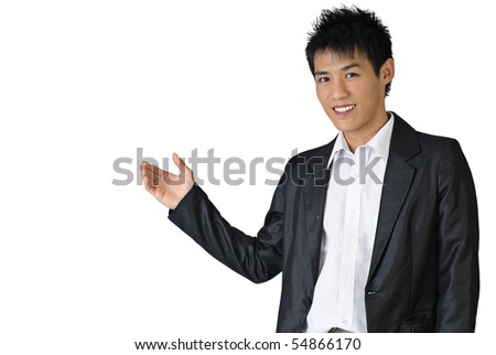 Portrait of a happy business man of Asian showing something on white background. - stock photo