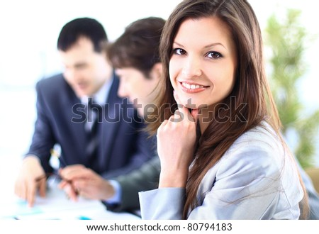Portrait of a Happy business woman smiling at camera - stock photo