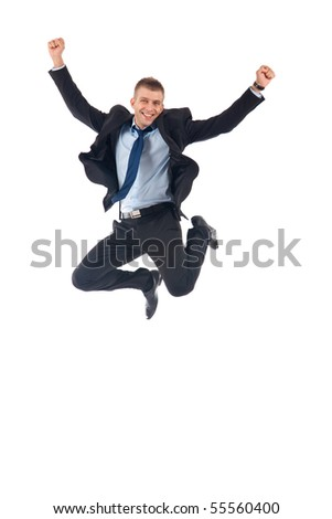 Portrait of a happy businessman jumping in air against isolated white background - stock photo