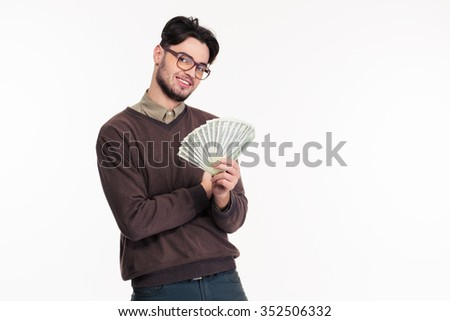 Portrait of a happy casual man in glasses hlding money isolated on a white background - stock photo