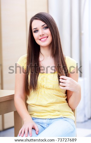 Portrait of a happy casual woman resting at home - stock photo