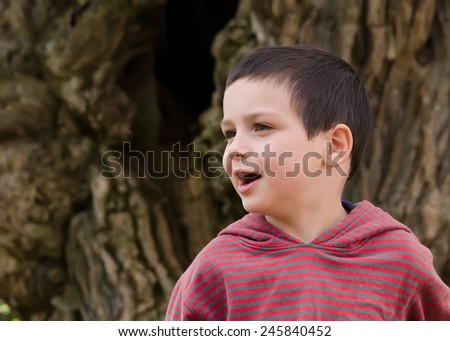 Portrait of a happy child boy outdoors. - stock photo