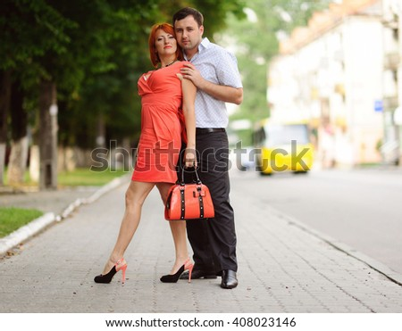 Portrait of a happy couple outdoor - stock photo