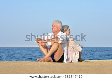 Portrait of a happy cute senior couple at sea - stock photo
