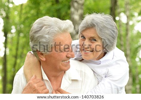 portrait of a happy elder couple in the late spring outside - stock photo