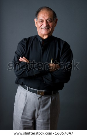 Portrait of a happy elderly East Indian businessman