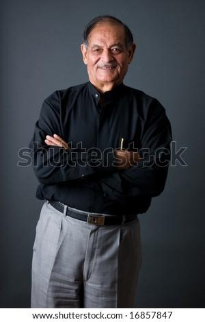 Portrait of a happy elderly East Indian businessman - stock photo