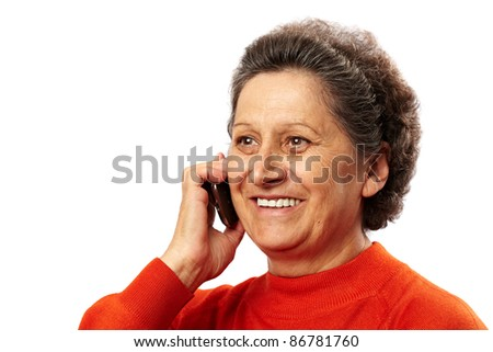 Portrait of a happy elderly woman speaking on mobile phone - stock photo