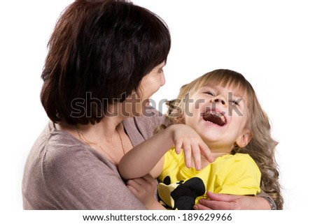 portrait of a happy embracing grandmother and granddaughter on white background - stock photo