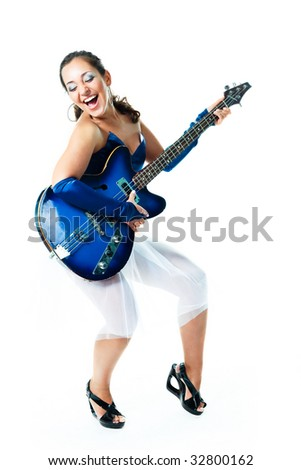 portrait of a happy excited brunette girl with a guitar - stock photo