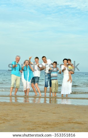 Portrait of a happy family at beach in summer