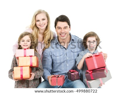 Portrait of a happy family isolated on white background. Christmas presents.