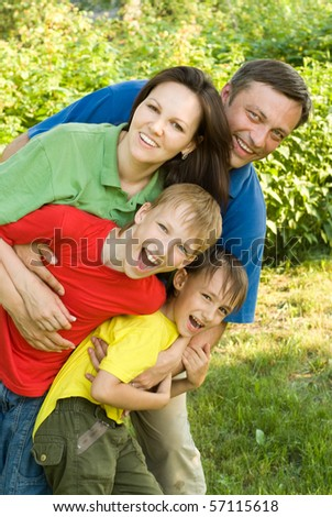 portrait of a happy family of four - stock photo