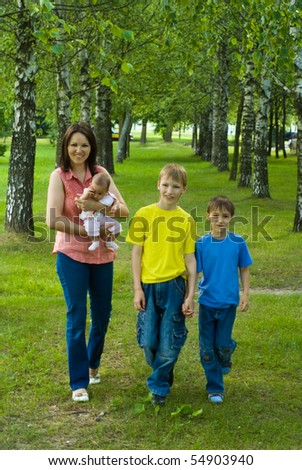 portrait of a happy family of four on the nature