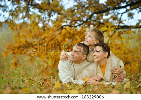 Portrait of a happy family of three on the nature