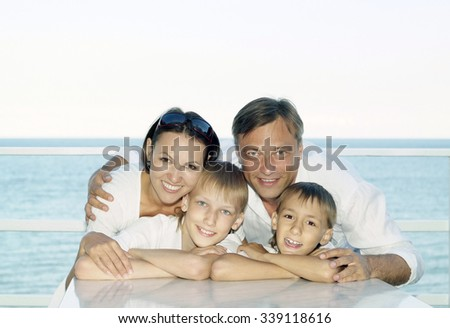 Portrait of a happy family on ship in summer