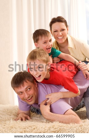 portrait of a happy family on the carpet