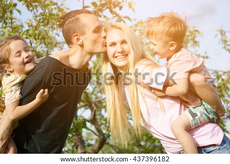 Portrait of a happy family outdoors - stock photo