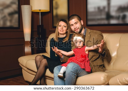 Portrait of a happy family, photo studio - stock photo