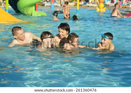 Portrait of a happy family relax in the pool - stock photo