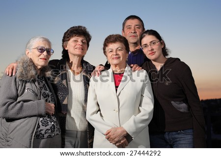 Portrait of a happy family together outdoors - stock photo