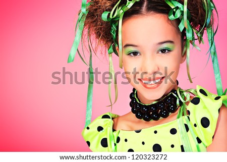 Portrait of a happy funny girl with holiday make-up, hairstyle and dress. - stock photo