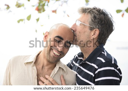 Portrait of a happy gay couple in love - stock photo