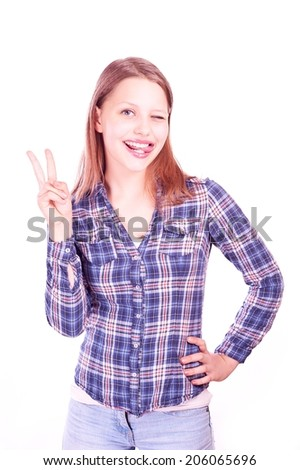 Portrait of a happy gesturing teen girl - stock photo