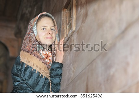 Portrait of a happy girl, it's snowing. - stock photo