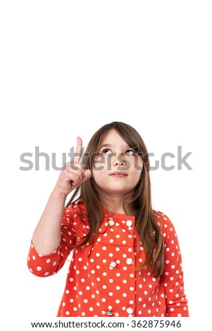 Portrait of a happy girl pointing up over white background - stock photo