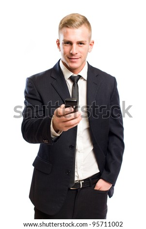 Portrait of a happy handsome young businessman using mobile phone.