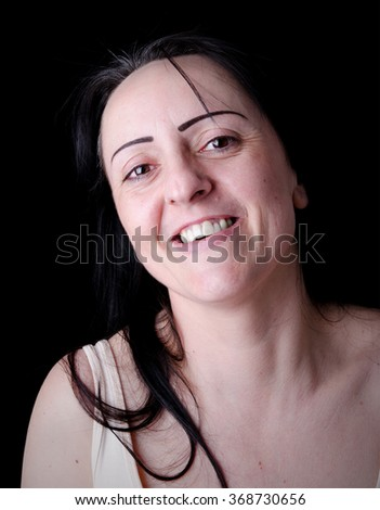 Portrait of a Happy laughing woman. Black background. - stock photo