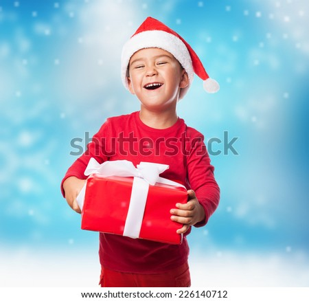 portrait of a happy little boy holding a new gift - stock photo
