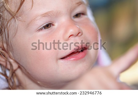 Portrait of a happy little girl close-up