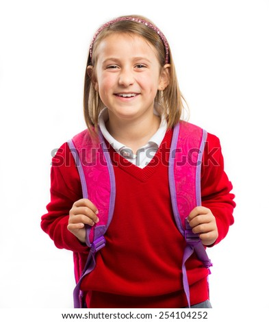 Portrait of a happy little girl with a school bag isolated on white background - stock photo