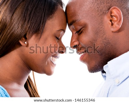 Portrait of a happy loving couple with heads together  - stock photo